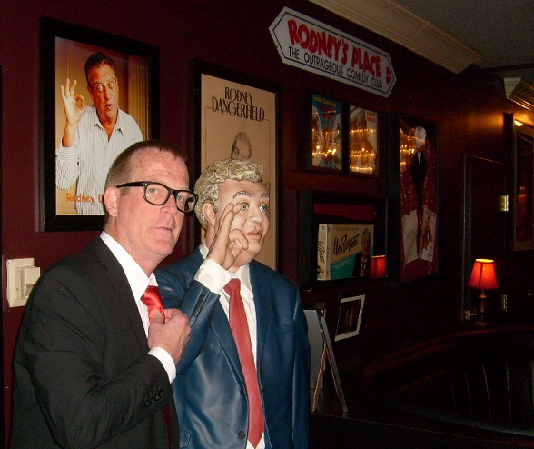 The Male Half posing November 22 with Rodney statue, adjacent to the Rodney Booth at the Las Vegas Laugh Factory.  (His contorted face is caused by the fact that he's doing his Rodney impression.)